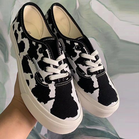 Cow print lace-up skate shoe