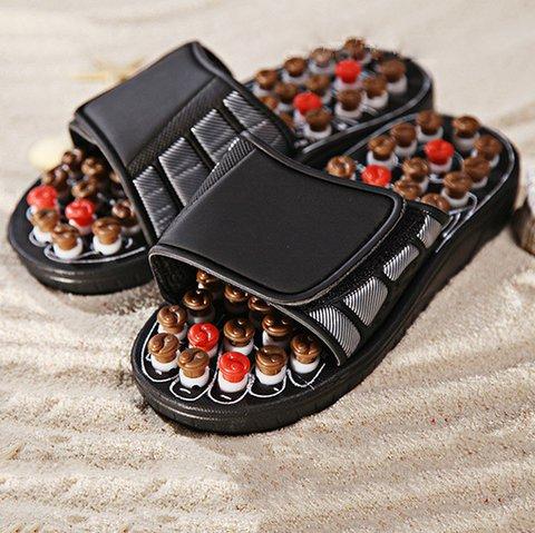 Rotating massage health slippers