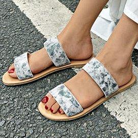 A word of casual casual casual casual with a pair of sandals