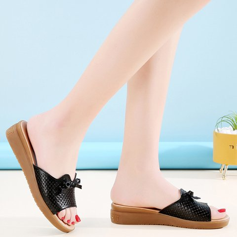 Hollow-Out Flat Heel Artificial Leather Bow Slippers